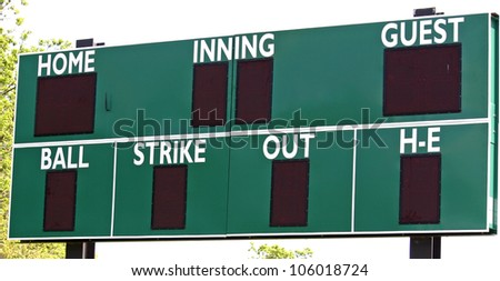 A green scoreboard in the outfield of a baseball field - stock photo