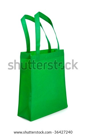 A green shopping bag with handles with copy space