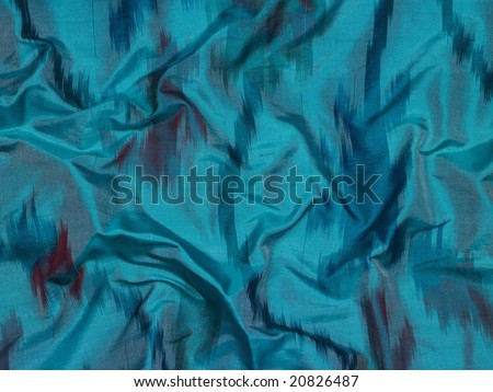 A green silky fabric cloth background