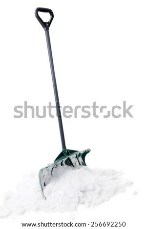 A green snow shovel standing upright in a small pile of snow.  On a white background. - stock photo