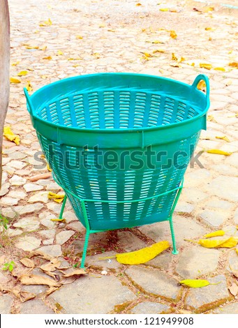 A green trash is in the garden. - stock photo