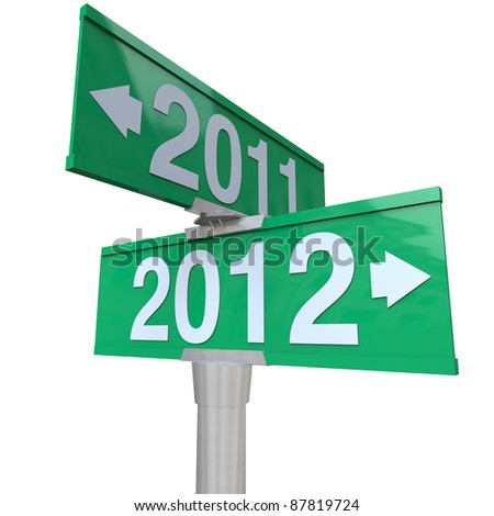 A green two-way street sign pointing to the years 2011 and 2012 with arrows leading to the past or the future, perfect for a symbol of the new year and the changing of times - stock photo