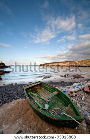 a green wood boat on the beach of puertito, canary Island of Tenerife, Spain