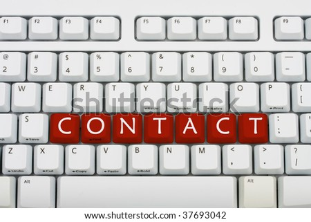 A grey keyboard with the word contact, contacting us
