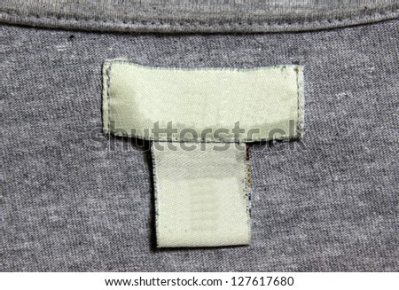 A grey shirt and a white label. - stock photo