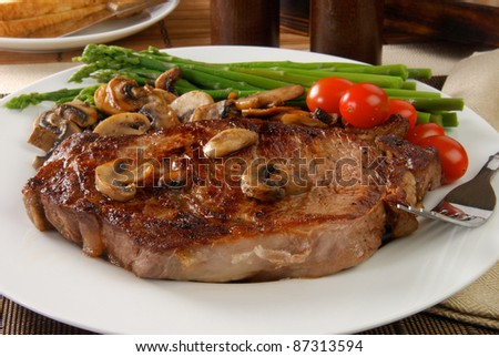 a grilled rib steak with sauteed mushrooms