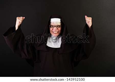 A grimacing nun with clenched fists