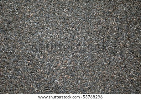 A gritty background texture of rough asphalt - stock photo
