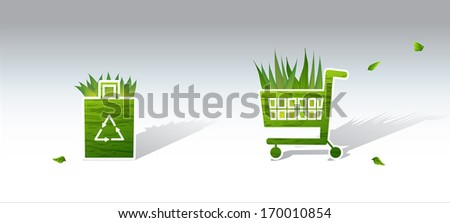 A grocer green cart saying to recycle. - stock photo