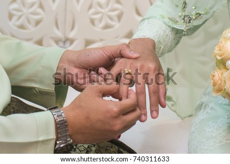 Grooms Hand Holding Brides Hand Wearing Stock Photo Safe to Use