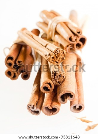 a group cinnamon sticks isolated on white. Different cinnamon sticks on white background. - stock photo