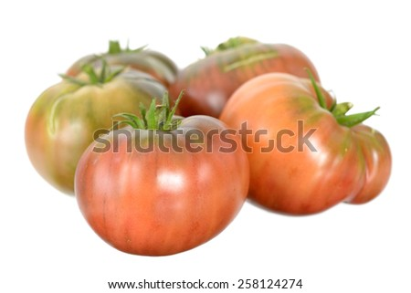 a group heirloom tomato isolated on white background  - stock photo