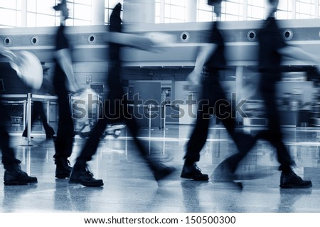A group of airport security Crew Walking in the Airport - stock photo