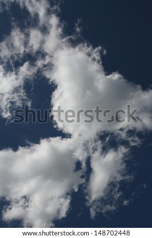 A group of Altocumulus clouds with a blue sky - stock photo