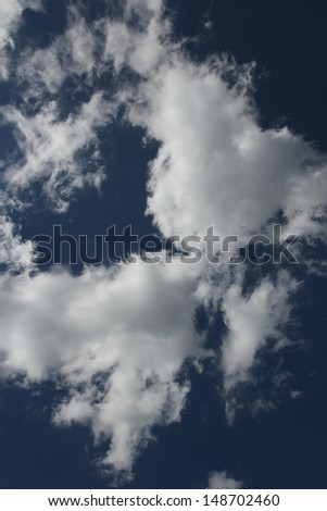 A group of Altocumulus clouds with a blue sky