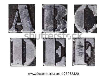 A group of antique lead letterpress letters - stock photo