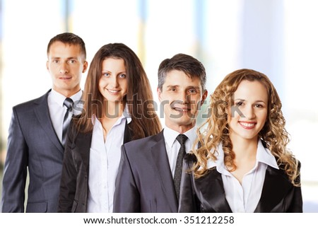 A group of attractive and successful business, ready for serious work. - stock photo