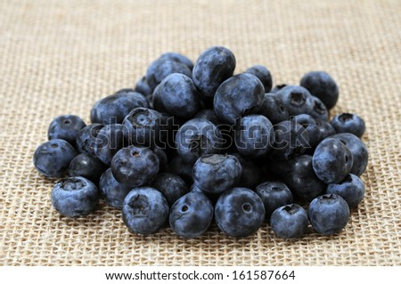 a group of blueberry on burlap