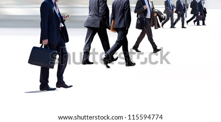 A group of business people on a light background. Urban scene. - stock photo