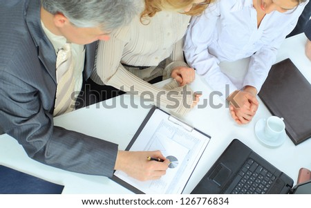 A group of businessmen at the meeting. - stock photo