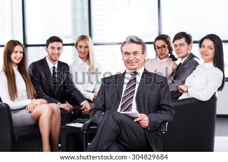 A group of businessmen discussing the policy of the company in the office. - stock photo