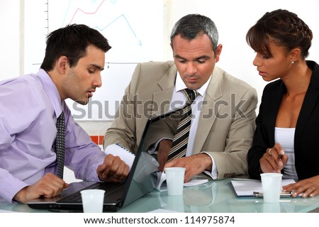 A group of businesspeople having a meeting - stock photo