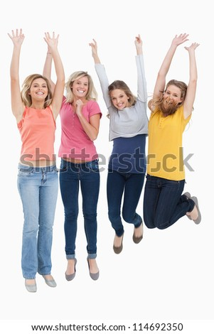 A group of celebrating girls jumping up in the air together - stock photo