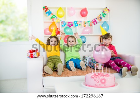 A group of children at a birthday party. A little blurred motion and shallow doff.