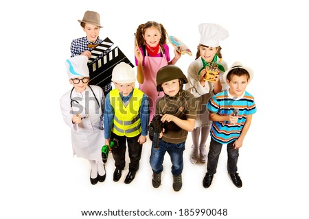 A group of children dressed in costumes of different professions. Isolated over white. - stock photo