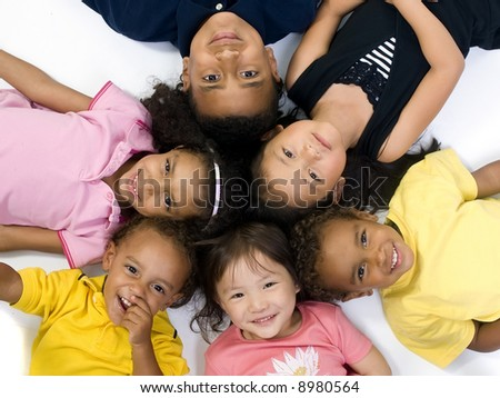 A group of children of various ethnic backgrounds. Diversity - stock photo