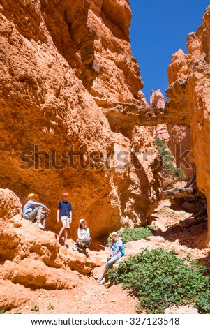 A group of children on the background Double Bridge, Navajo loop. Bryce Canyon National Park, Utah - stock photo