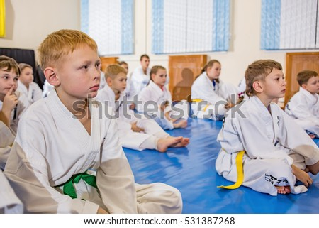 A group of children sitting in the classroom for Taekwondo in the gym. Editorial. Rybinsk, Russia.  12.11.2016
