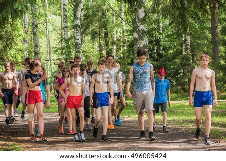 "A group of children walking in the Park after a workout. Children's camp ""Berezka"". Editorial. Russia. Yaroslavl region.   02.06.2016"