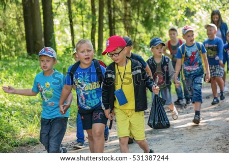 "A group of children walking in the Park.  Children's camp ""Berezka"". Editorial. Russia. Yaroslavl region. 23.06. 2016"