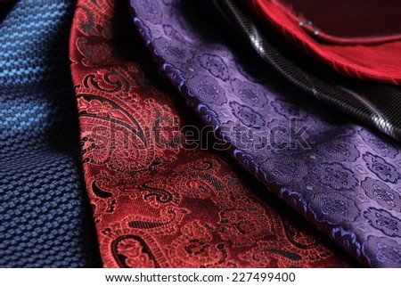 A group of classic and modern silk ties set in spiral arrangement. Blue, red , purple, bordeaux and black colors - stock photo