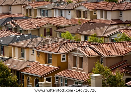 A group of closely-spaced tract homes in San Jose, California. - stock photo