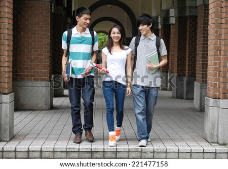 A group of college friends at a campus walking - stock photo
