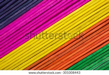 A group of colorful craft sticks at an angle.