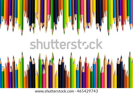 A group of colorful crayons on the top and bottom edge on white background