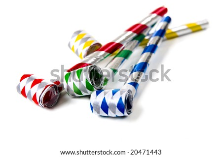 A group of colorful party noisemakers on a white background.  New Years Eve or birthday theme