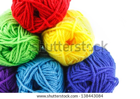A group of colorful yarn on left side on white background