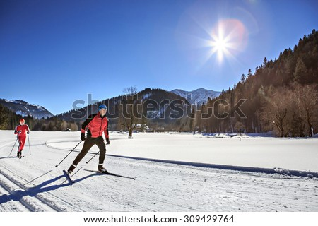 A group of cross-country skiers on the trail in Bavaria - stock photo
