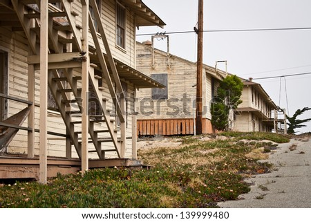 A group of dilapidated, abandoned buildings. - stock photo