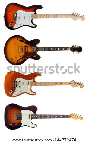 A group of five electric guitars on a white background - stock photo