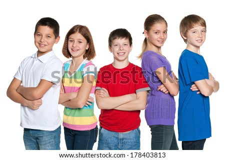 A group of five happy children are standing on the white background