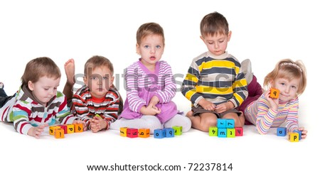 A group of five kids with different emotions are playing colorful blocks; isolated on the white background
