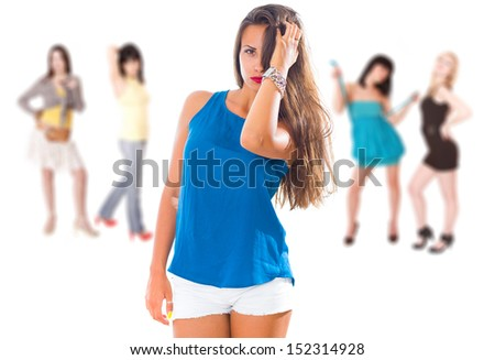 A group of five young women in casual clothing on white background - stock photo