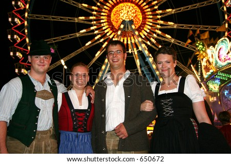 A group of four German Oktoberfest fans - stock photo