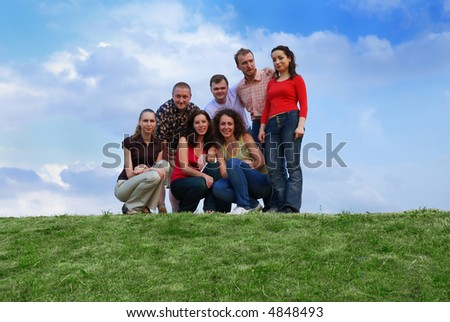 A group of friends against sky