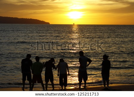 A group of friends and sunset silhouette in Sabah